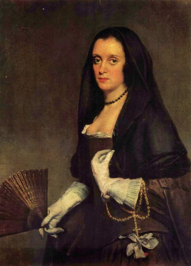 Diego Velázquez. Dama del Abanico. c 1635. Wallace Colection. Londres. La dama lleva mantilla, abanico y rosario los elementos característicos de la mujer española.