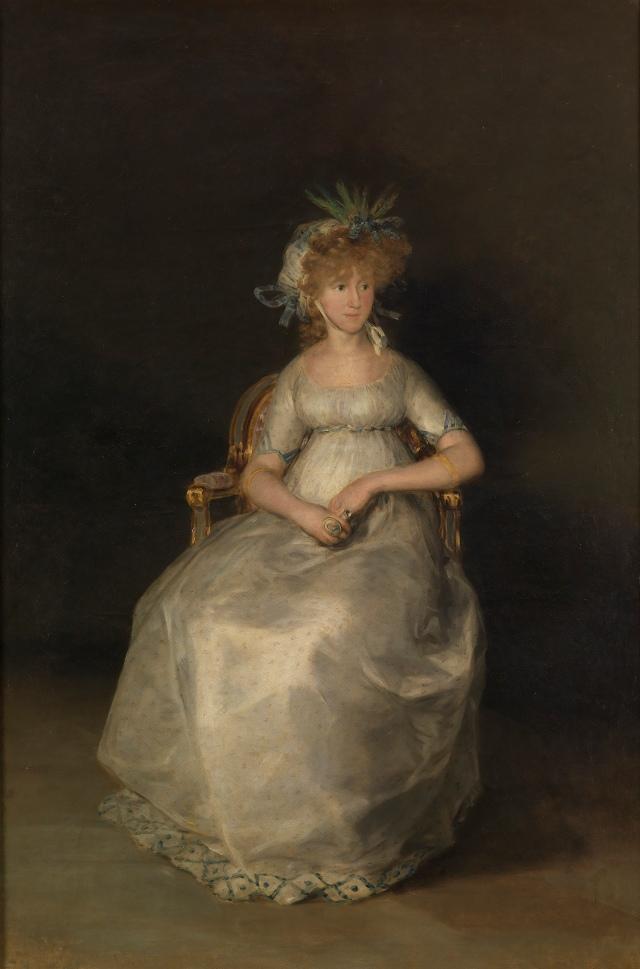 """Francisco de Goya. """"Condesa de Chinchón"""". 1800. Museo del Prado. Madrid. María Teresa de Borbón aparece sentada sobre un fondo neutro, sin mirar al espectador. Su avanzado estado de gestación queda disimulado por la postura de sus manos. Llama la atención su precioso tocado de espigas. Las radiografías confirman que debajo hay dos retratos masculinos, uno del mismo Godoy. Se apunta que tal vez no le gustase y se lo devolviera a Goya, ¡Es para no dar crédito!"""