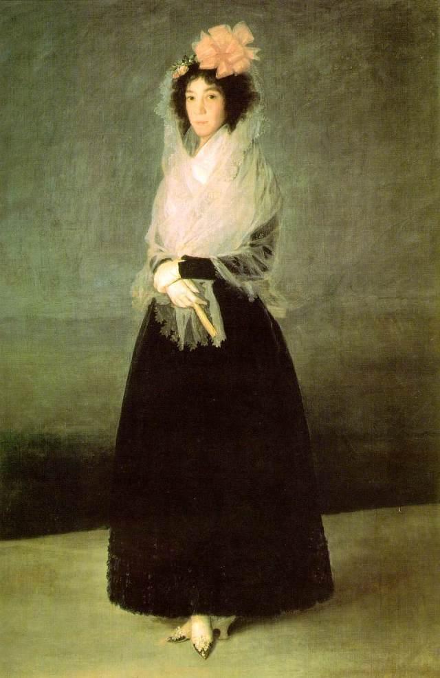 Francisco de Goya. Marquesa de La Solana. 1794-95. Museo del Louvre. Paris. La marquesa luce un enorme lazo y su mantilla blanca cae desde la cabeza recogiéndose en los brazos en forma de chal.