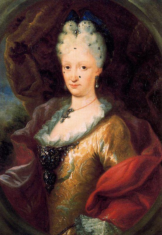 Miguel Jacinto Meléndez. Isabel de Farnesio. 1718. Casa de la Moneda. Madrid. Los lunares que aparecen en el rostro de la reina eran de quita y pon. Una curiosa moda femenina del siglo XVIII. Normalmente eran de terciopelo negro.